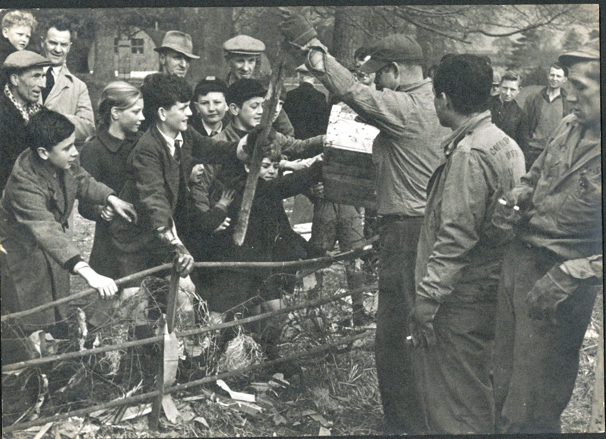 US soldiers give away scrap wood to local people, Honiton, Devon