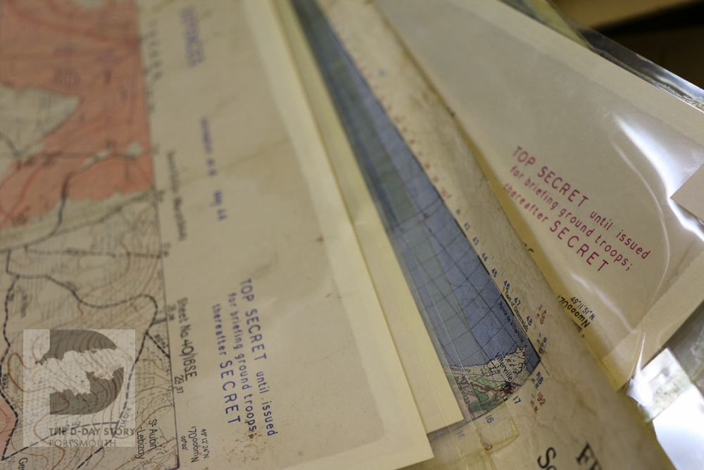 Photograph showing top secret maps and documents used in the planning of Operation Neptune
