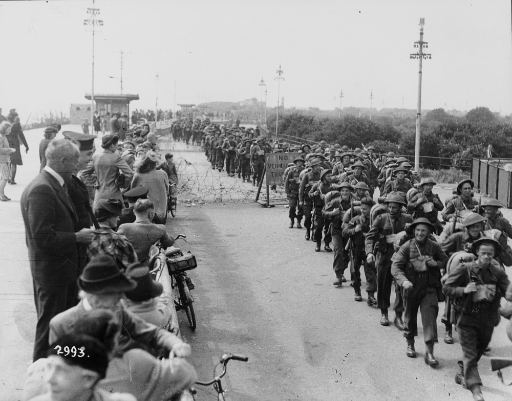 This photograph shows British soldiers on the Southsea seafront. They are about to board landing craft bound for Normandy.