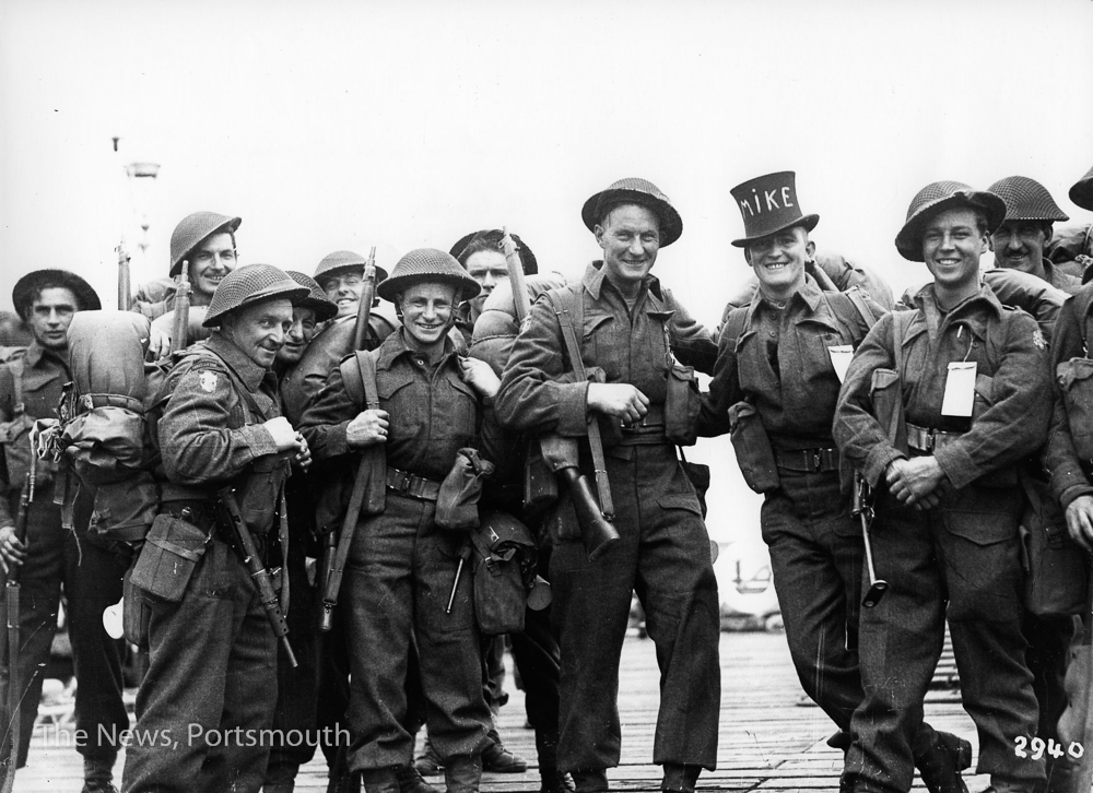 Royal Canadian Engineers about to board landing craft at South Parade Pier, Portsmouth.