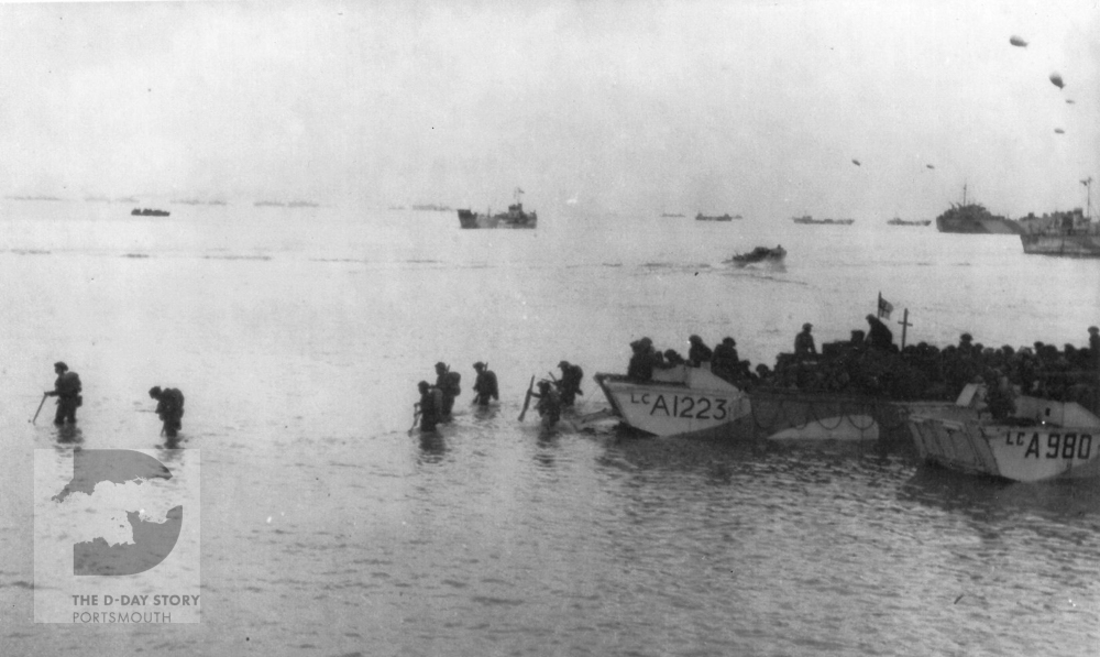 Infantry from the Regiment de la Chaudiere disembarking from Royal Navy Landing Craft, Assault (LCA) on Nan sector of Juno Beach at 9am on D-Day.