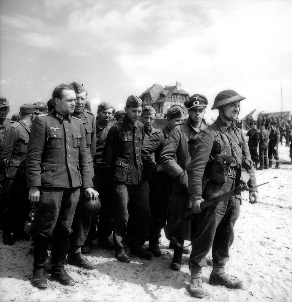 German prisoners of war under guard on D-Day at Bernières-sur-mer, Juno Beach.