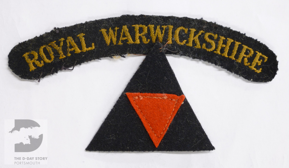 A Royal Warwickshire Regiment shoulder title and a triangular 3rd British Division badge. They were worn during the Battle of Normandy by John Gundy, who was a company runner serving with 2nd Royal Warwicks.