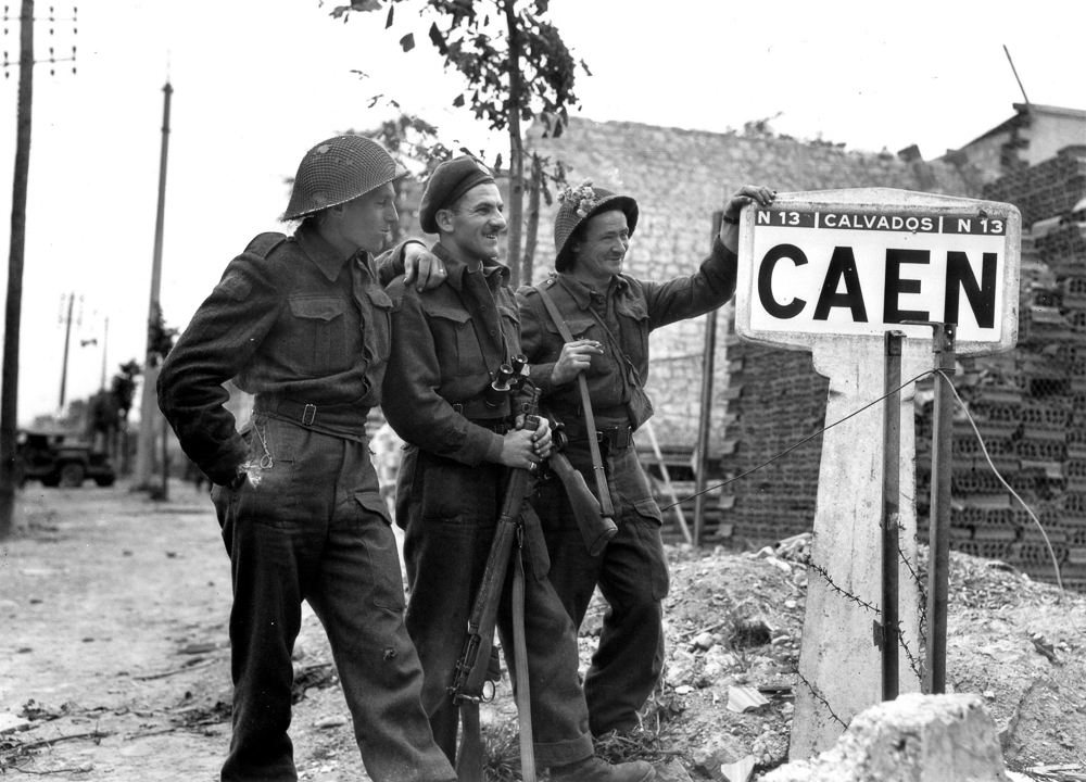 Three Canadian soldiers on the outskirts of Caen, 9 July 1944.