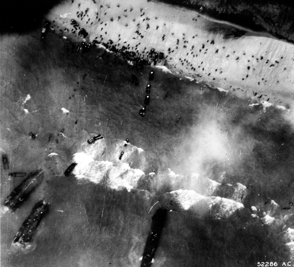 An aerial photograph of US troops landing at Utah Beach.