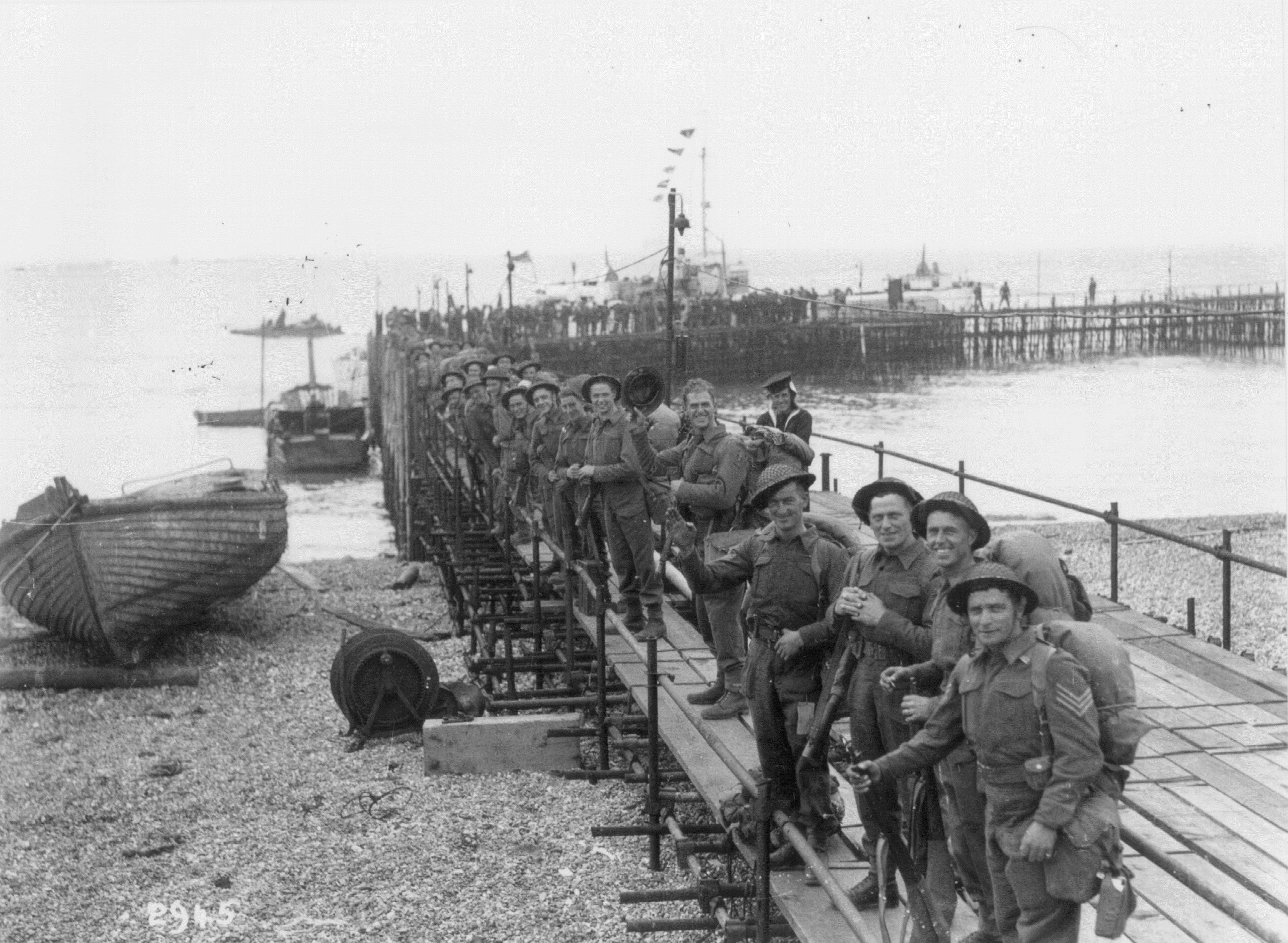 Royal Engineers prepare to board a landing craft near South Parade Pier in Portsmouth. Copyright The News, Portsmouth.